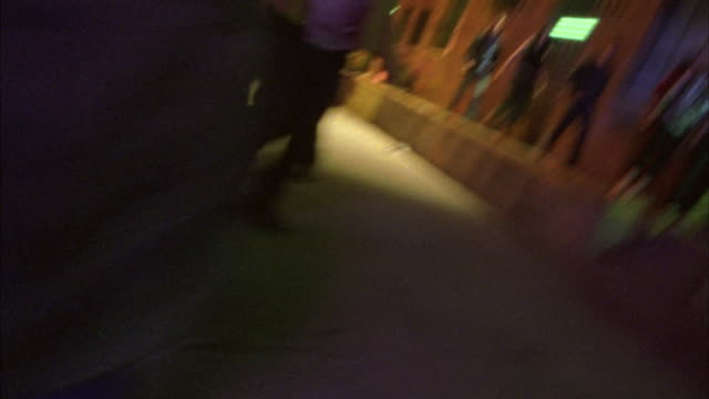 a brawl breaks out on a downtown street in front of a nightclub. - shaky stock videos & royalty-free footage