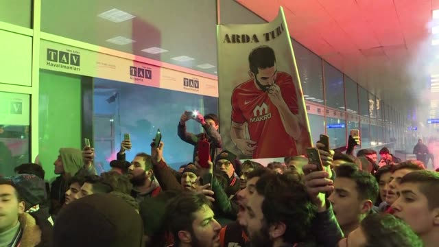 A brawl erupts in an airport in Istanbul where as midfielder Arda Turan returned home on loan from Barcelona