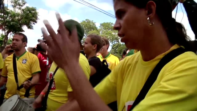 brazil 2014 world cup: brazil-germany semi-final; brazil: belo horizonte: ext brazilian supporters drumming before nthe 2014 world cup semi-final... - 2014 stock-videos und b-roll-filmmaterial
