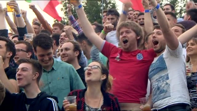 brazil 2014 world cup: england beaten by uruguay; england: manchester: various shots of england fans celebrating goal by rooney - uruguay stock videos & royalty-free footage