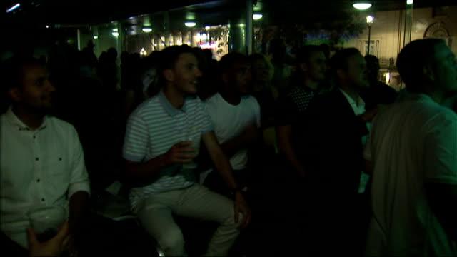 England fans watching match England fans in pub watching match and celebrating after England score goal