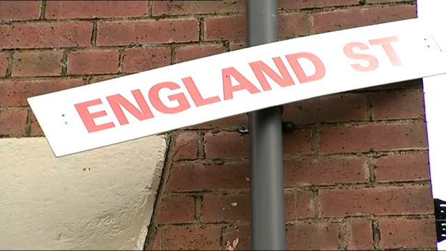 england prepares wide shots of wales street and houses decorated with england flags 'england' signs in house window 'wales street' road sign with... - street name sign stock videos and b-roll footage
