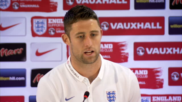 england team arrive in manaus int gary cahill press conference sot on being acclimatized to heat - manaus stock videos and b-roll footage