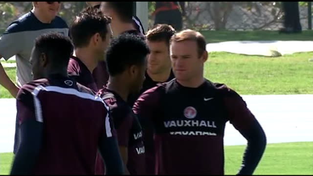England team training More of Rooney along during training / Rooney and Milner chatting / England team at training ground including Frank Lampard...