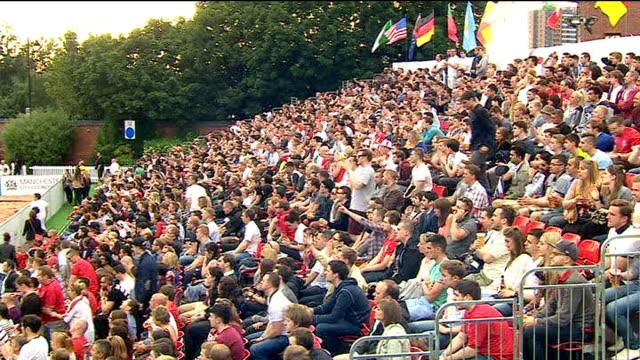 Fan watching England v Uruguay match ENGLAND Manchester EXT Various shots fans watching match on big screen in stadium