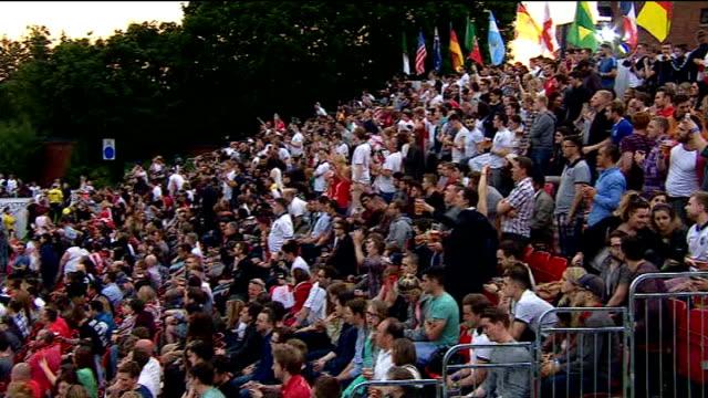 brazil 2014 world cup: fan watching england v uruguay match; various shots fans watching match on big screen in stadium - international team soccer stock videos & royalty-free footage