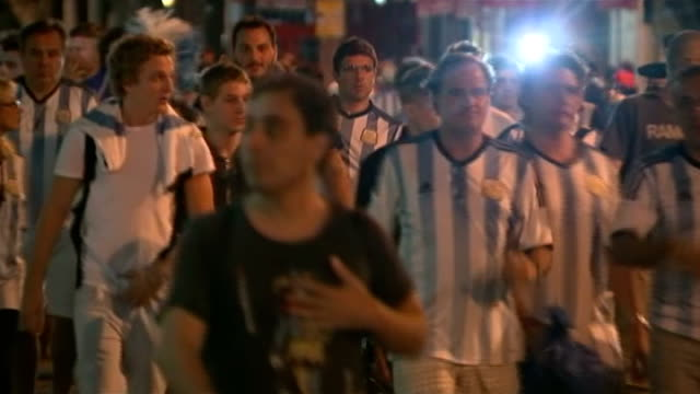 brazil 2014 world cup final: germany beat argentina; argentinian fans along back view argentina fans with messi shirts on away - argentina stock-videos und b-roll-filmmaterial