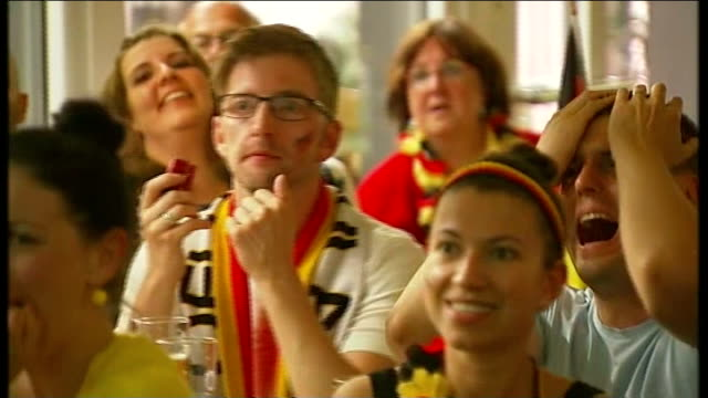 brazil 2014 world cup final: germany beat argentina; various shots of german fans watching world cup final match in restaurant - final round stock videos & royalty-free footage