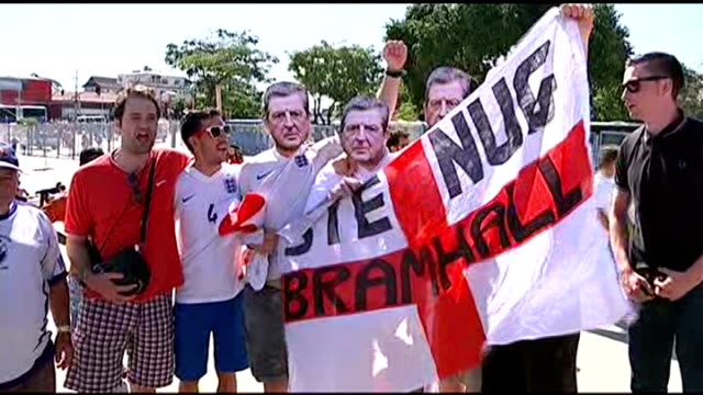 Highlights BRAZIL Belo Horizonte EXT Group of England footballs fans wearing Roy Hodgson face masks singing and dancing outside stadium ahead of...