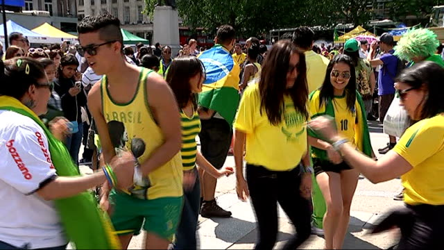 reaction in london to brazilian defeat lib england london trafalgar square ext brazilian football fans dancing in trafalgar square at the start of... - pop music stock-videos und b-roll-filmmaterial