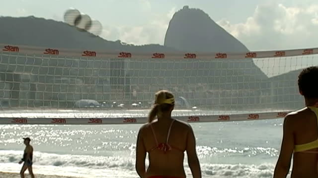 reaction to brazil losing semifinal brazil rio de janeiro ext various of women in bikinis playing volleyball on beach man playing beach volleyball... - semifinal round stock videos & royalty-free footage