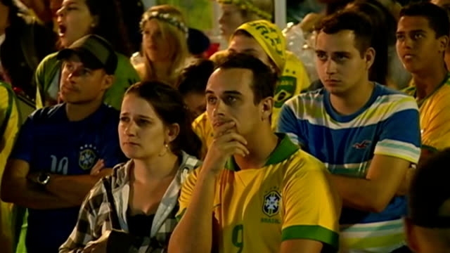 Reaction to Brazil losing semifinal LOCATION Football fans watching game Woman crying