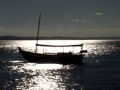 ms, brazil, bahia, morro de sao paulo, silhouette of boat anchored in sea at sunset - anchored stock videos & royalty-free footage