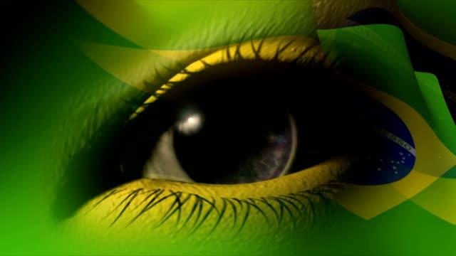 vídeos de stock, filmes e b-roll de olho com bandeira do brasil - bandeira