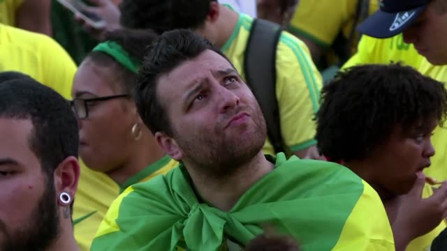 brazil fans are devastated after their team loses 21 to belgium in the quarterfinals game disqualifying them from the world cup - quarterfinal round stock videos & royalty-free footage