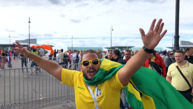 vídeos de stock, filmes e b-roll de brazil fans enjoy the pre match atmosphere prior to the 2018 fifa world cup russia group e match between brazil and costa rica at saint petersburg... - russia
