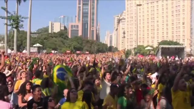 Brazil fans go wild as Neymar scores a goal against Mexico after a stale first half while Mexico fans worry about their prospects in reaching the...