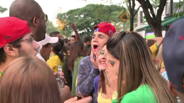 brazil fans in sao paulo watched in bitter dismay as their side were crushed in a humiliating 17 defeat to germany in the world cup semi final - semifinal round stock videos & royalty-free footage