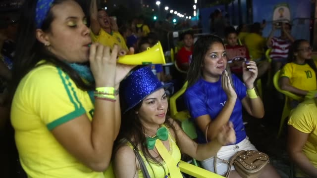 ms brazil fans watch their match in copacabana before their victory in their 2014 fifa world cup match against colombia on july 4 2014 in rio de... - national team stock videos & royalty-free footage