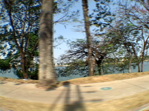 side pov, fish eye, brazil, minas gerais, belo horizonte, pampulha, driving along lake - horizonte stock videos & royalty-free footage