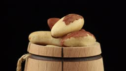 Brazil nut in a barrel spinning close-up