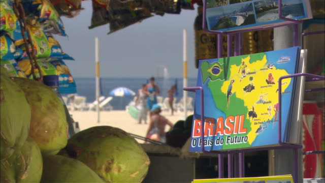 cu brazil postcard for sale at fruit stand on beach/ brazil - unknown gender stock videos & royalty-free footage