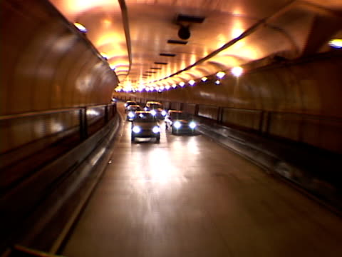 rear pov, pov, brazil, sao paulo, traffic in tunnel at night - traffic点の映像素材/bロール