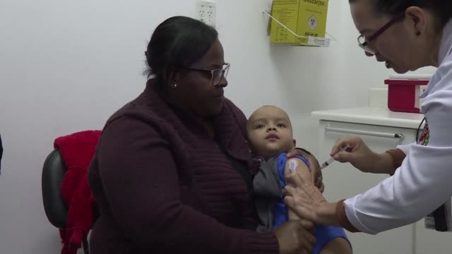 brazil starts an immunization campaign to vaccinate 11 million children against measles which the health ministry believes has resurfaced because of... - mmr stock videos and b-roll footage