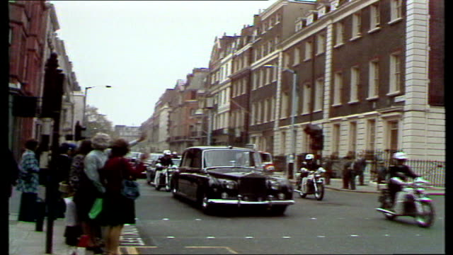 brazil state visit demonstrations england london claridges hotel gv cars and police escort towards ms demos and police ms president wife and daughter... - state visit stock videos & royalty-free footage