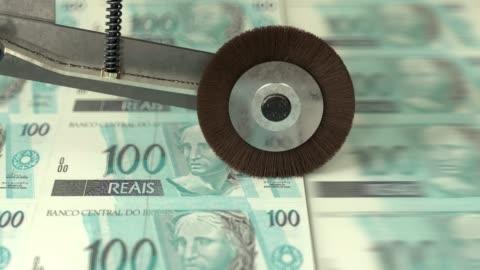 stockvideo's en b-roll-footage met braziliaanse 100 reals worden afgedrukt - economie