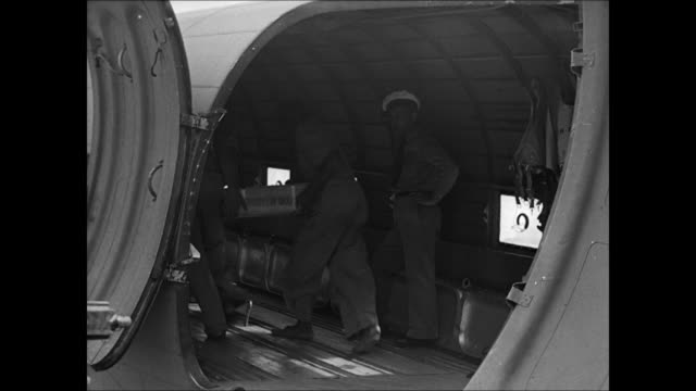 vídeos de stock, filmes e b-roll de brazilian amp us men loading supplies into cargo airplane hold ms nose of cargo airplane engines starting ms american officer signing boarding... - base militar