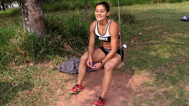 brazilian athlete ana claudia lemos silva plays on an improvised swing during a training session at the shoulder of the imigrantes highway on... - pan american highway stock videos & royalty-free footage