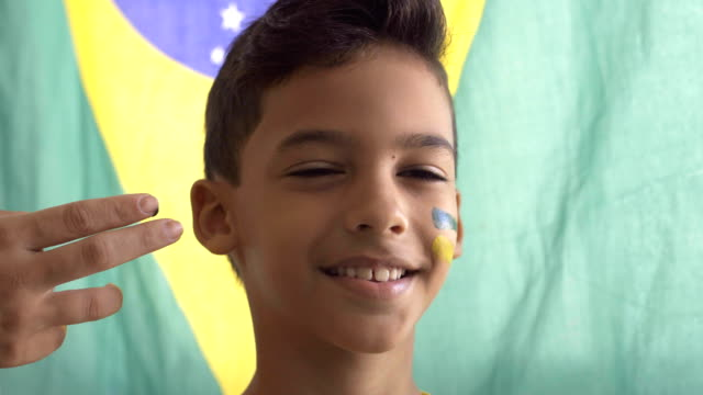 brazilian boy - bandiera nazionale video stock e b–roll