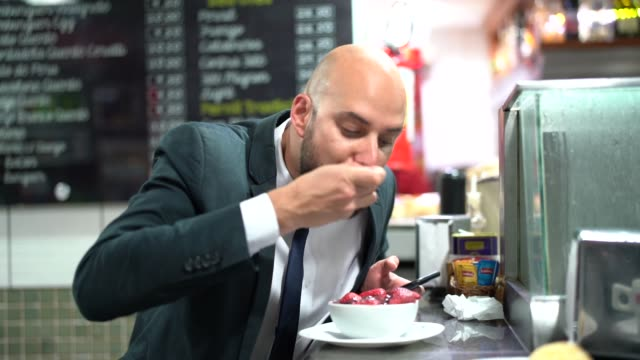 brazilian business man eating acai - belém brazil stock videos and b-roll footage