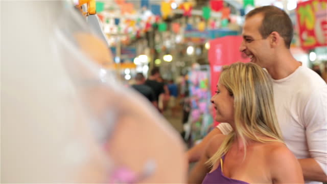 brazilian couple shop for shoes in rio marketplace - flip flop stock videos and b-roll footage