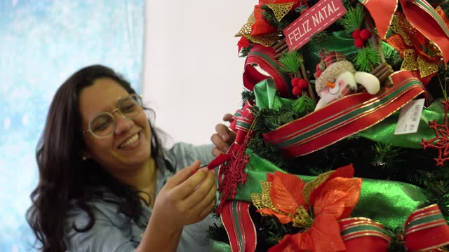 brazilian family decorating christmas tree - pardo brazilian stock videos & royalty-free footage
