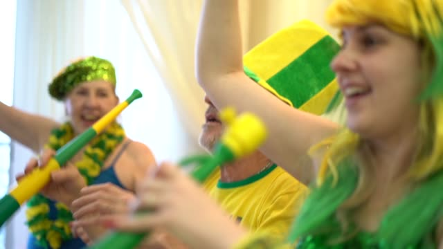 brazilian family watching soccer game at home - fan enthusiast stock videos & royalty-free footage