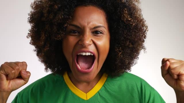 brazilian fan celebrating, looking at camera - cheering stock videos & royalty-free footage