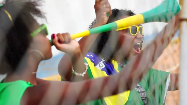 brazilian fan friends celebrating in a soccer game - fan enthusiast stock videos & royalty-free footage