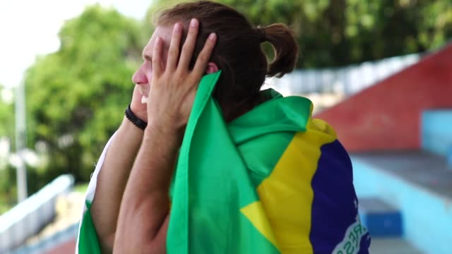 brazilian fan watching a soccer game - international soccer event stock videos & royalty-free footage
