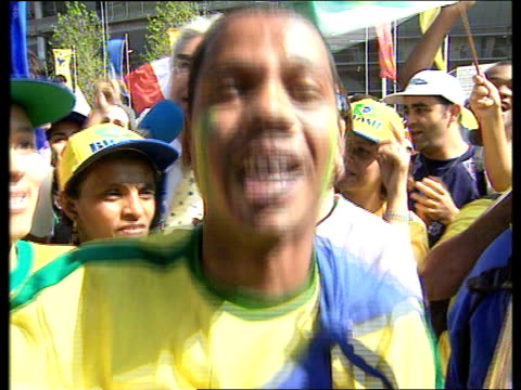 Brazilian fans gather for World Cup final ITN Paris Brazilian band playing outside State de France SOT Brazilian fans singing Miller i/c
