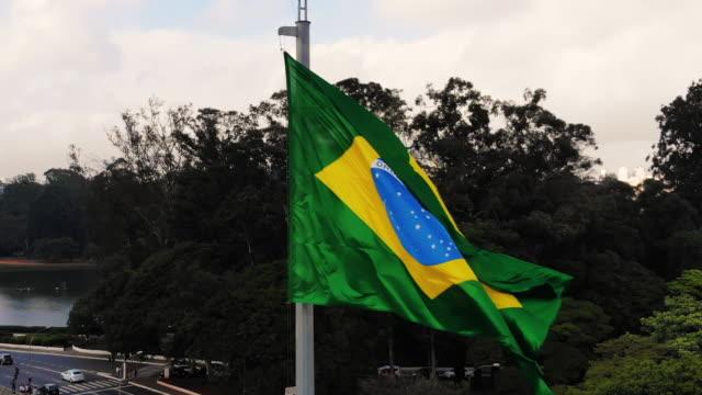 brazilian flag fluttering - hd format stock videos & royalty-free footage