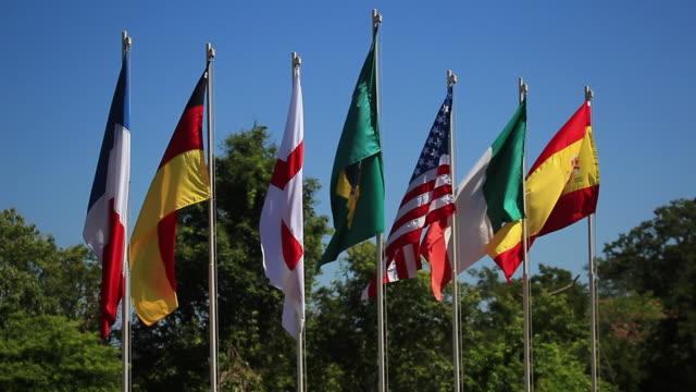 ws brazilian, french, german, english, american, italian and spanish flags / foz do iguacu, parana, brazil - bandiera inglese video stock e b–roll