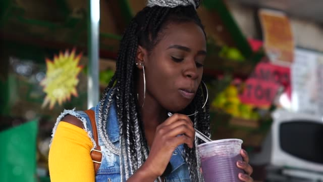 brazilian girl eating açai acai bowl - belém brazil stock videos and b-roll footage