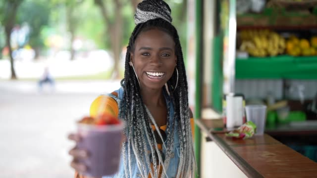 brazilian girl showing açai acai bowl - belém brazil stock videos and b-roll footage