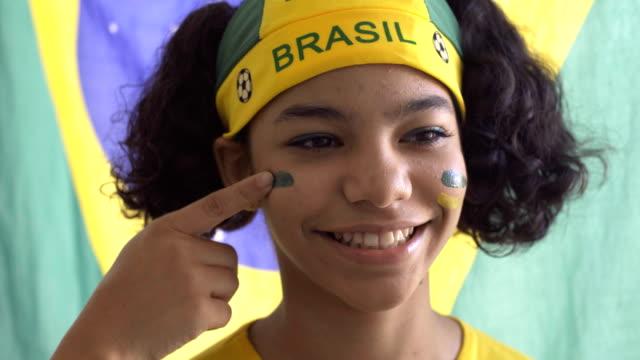 brazilian girl - bandiera nazionale video stock e b–roll
