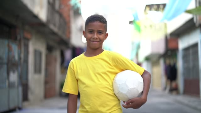 brazilian kid playing soccer portrait - south america stock videos & royalty-free footage