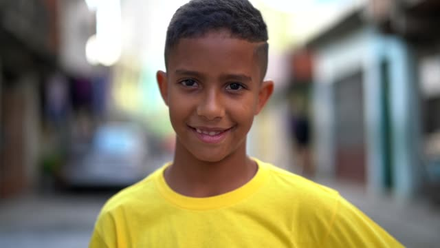 brazilian kid portrait at favela - povertà video stock e b–roll