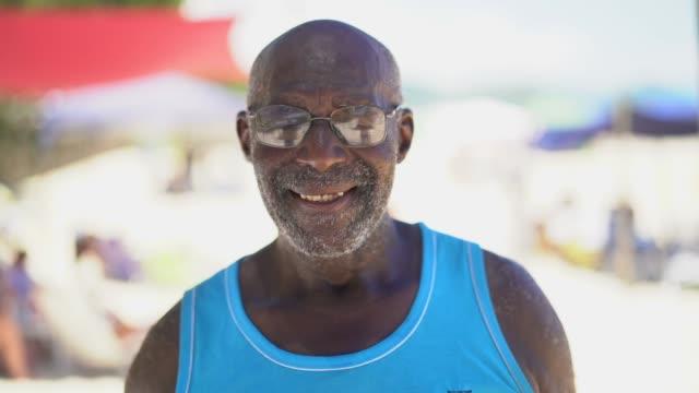 brazilian man portrait at beach - pardo brazilian stock videos & royalty-free footage