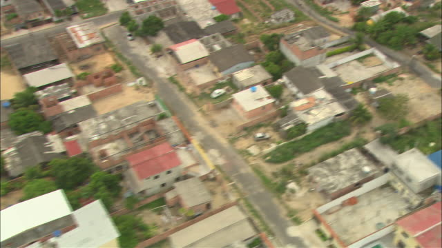 a brazilian neighborhood shows evidence of deterioration. - run down stock videos & royalty-free footage